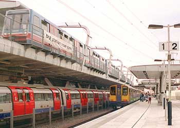 Various electric railways at Canning Town station in London. Top; Docklands Light Railway (light rail); Below: Jubilee Line (heavy rail - city specific underground / metro / subway). Right; North London Line (heavy rail - national mainline / urban).